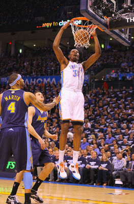 OKLAHOMA CITY, OK - APRIL 27: Kevin Durant #35 of the Oklahoma City Thunder dunks the ball against the Denver Nuggets in Game Five of the Western Conference Quarterfinals in the 2011 NBA Playoffs on April 27, 2011 at the Ford Center in Oklahoma City, Okla