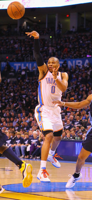 OKLAHOMA CITY, OK - APRIL 27: Russell Westbrook #0 of the Oklahoma City Thunder passes the ball against Arron Afflalo #6 of the Denver Nuggets in Game Five of the Western Conference Quarterfinals in the 2011 NBA Playoffs on April 27, 2011 at the Ford Cent