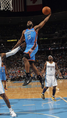 DENVER, CO - APRIL 25:  James Harden #13 of the Oklahoma City Thunder takes a shot over Al Harrington #7 of the Denver Nuggets in Game Four of the Western Conference Quarterfinals in the 2011 NBA Playoffs on April 24, 2011 at the Pepsi Center in Denver, C