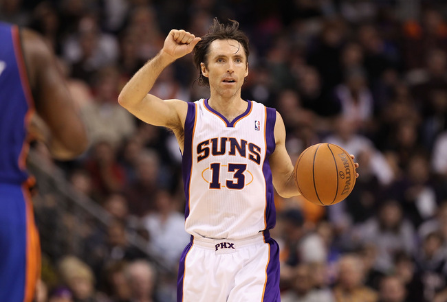 PHOENIX, AZ - JANUARY 07:  Steve Nash #13 of the Phoenix Suns handles the ball during the NBA game against the New York Knicks at US Airways Center on January 7, 2011 in Phoenix, Arizona.  The Knicks defeated the Suns 121-96.  NOTE TO USER: User expressly
