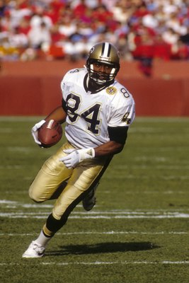 SAN FRANCISCO - DECEMBER 01:  Wide receiver Eric Martin #84 of the New Orleans Saints runs with the ball during the game against the San Francisco 49ers at Candlestick Park on December 1, 1991 in San Francisco, California.  The 49ers won 38-24.  (Photo by