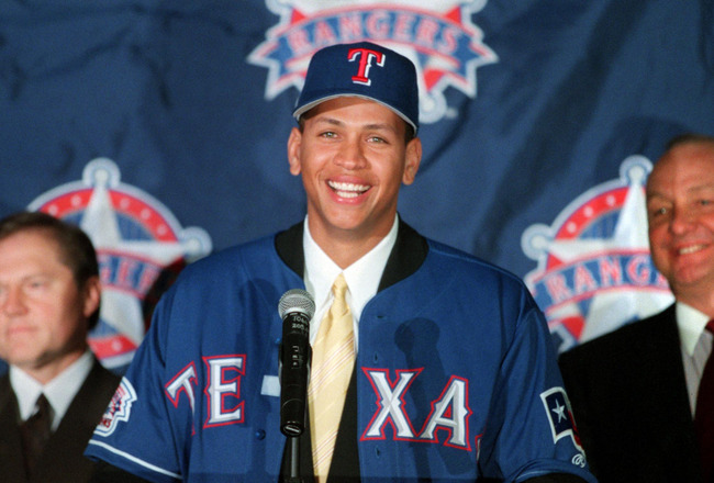 12 Dec 2000:  Newly signed Texas Ranger Alex Rodriguez, center, is introduced to the media by club owner Tom Hicks, right, and Rodriguez' agent Scott Boras during a press conference at The Ballpark in Arlington, Texas. Mandatory Credit: Gary Barber/ALLSPO