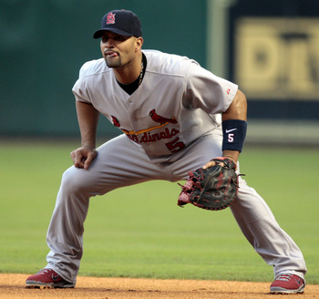 HOUSTON - APRIL 27:  First baseman Albert Pujols #5 of the St. Louis Cardinals waits for the next batter against the Houston Astros at Minute Maid Park on April 27, 2011 in Houston, Texas.  (Photo by Bob Levey/Getty Images)