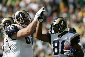 GREEN BAY, WI - OCTOBER 8:  Wide receiver Torry Holt #81 of the St. Louis Rams high fives offensive guard Adam Timmerman #62 during the game against the the Green Bay Packers at Lambeau Field on October 8, 2006 in Green Bay, Wisconsin. The Rams defeated t