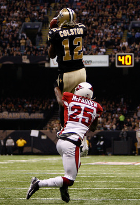 NEW ORLEANS - JANUARY 16:  Marques Colston #12 of the New Orleans Saints makes a reception against Bryant McFadden #25 of the Arizona Cardinals during the NFC Divisional Playoff Game at Louisana Superdome on January 16, 2010 in New Orleans, Louisiana.  (P
