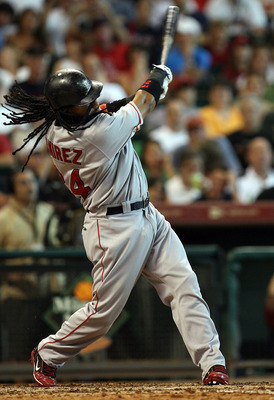 HOUSTON - JUNE 29:  Manny Ramirez #24 of the Boston Red Sox hits a solo home run against the Houston Astros in the seventh inning during an interleague MLB game at Minute Maid Park June 29, 2008 in Houston, Texas.  (Photo by Ronald Martinez/Getty Images)