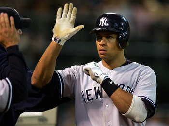 OAKLAND, CA - SEPTEMBER 4:  Alex Rodriguez #13 of the New York Yankees is congratulated after scoring in the 8th inning against the Oakland Athletics during a MLB game at McAfee Coliseum on September 4, 2005 in Oakland, California.  (Photo by Jed Jacobsoh