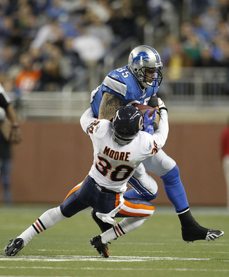DETROIT - DECEMBER 05: D. J. Moore #30 of the Chicago Bears stops Tony Scheffler #85 of the Detroit Lions during the fourth quarter of the game at Ford Field on December 5, 2010 in Detroit, Michigan. The Bears defeated the Lions 24-20. (Photo by Leon Hali