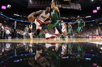 MIAMI, FL - APRIL 10:  Dwyane Wade #3 of the Miami Heat drives on Delonte West #13 of the Boston Celtics during a game  at American Airlines Arena on April 10, 2011 in Miami, Florida. NOTE TO USER: User expressly acknowledges and agrees that, by downloadi