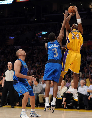 LOS ANGELES, CA - MARCH 31:  Kobe Bryant #24 of the Los Angeles Lakers shoots a jumper in front of Rodrique Beaubois #3 and Jason Kidd #2 of the Dallas Mavericks at Staples Center on March 31, 2011 in Los Angeles, California.  NOTE TO USER: User expressly