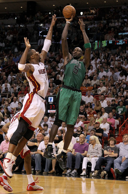MIAMI, FL - APRIL 10:  Kevin Garnett #5 of the Boston Celtics shoots over Chris Bosh #1 of the Miami Heat during a game at American Airlines Arena on April 10, 2011 in Miami, Florida. NOTE TO USER: User expressly acknowledges and agrees that, by downloadi