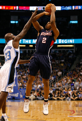 ORLANDO, FL - APRIL 26:  Joe Johnson #2 of the Atlanta Hawks shoots over Jason Richardson #23 of the Orlando Magic during Game Five of the Eastern Conference Quarterfinals of the 2011 NBA Playoffs on April 26, 2011 at the Amway Arena in Orlando, Florida.