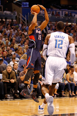 ORLANDO, FL - APRIL 26:  Al Horford #15 of the Atlanta Hawks shoots against the Orlando Magic during Game Five of the Eastern Conference Quarterfinals of the 2011 NBA Playoffs on April 26, 2011 at the Amway Arena in Orlando, Florida.  NOTE TO USER: User e