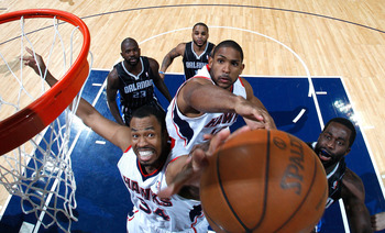 ATLANTA, GA - APRIL 28:  Jason Collins #34 and Al Horford #15 of the Atlanta Hawks battle for a rebound against Brandon Bass #30 of the Orlando Magic during Game Six of the Eastern Conference Quarterfinals in the 2011 NBA Playoffs at Philips Arena on Apri