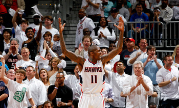 ATLANTA, GA - APRIL 28:  Jamal Crawford #11 of the Atlanta Hawks reacts to the fans after a basket against the Orlando Magic during Game Six of the Eastern Conference Quarterfinals in the 2011 NBA Playoffs at Philips Arena on April 28, 2011 in Atlanta, Ge