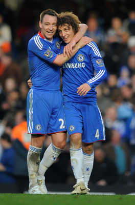 LONDON, ENGLAND - MARCH 20:  David Luiz and John Terry of Chelsea celebrate victory the Barclays Premier League match between Chelsea and Manchester City at Stamford Bridge on March 20, 2011 in London, England.  (Photo by Michael Regan/Getty Images)