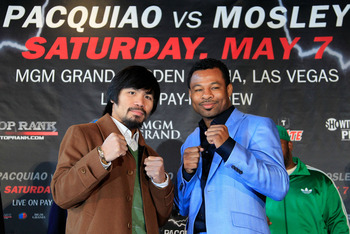 NEW YORK, NY - FEBRUARY 14:  Manny Pacquiao (L) and Shane Mosley pose for photographs to promote their upcoming fight at The Lighthouse at Chelsea Piers on February 14, 2011 in New York City.  (Photo by Chris Trotman/Getty Images)