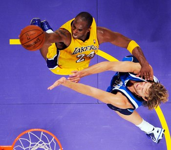 LOS ANGELES, CA - OCTOBER 30: Kobe Bryant #24 of the Los Angeles Lakers glides to the basket against Dirk Nowitzki #41 of the Dallas Mavericks during the NBA basketball game at Staples Center on October 30, 2009 in Los Angeles, California.  NOTE TO USER: