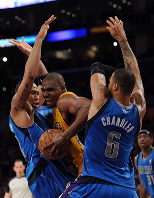LOS ANGELES, CA - MARCH 31:  Andrew Bynum #17 of the Los Angeles Lakers attempts to split the defense of Shawn Marion #0 and Tyson Chandler #6 of the Dallas Mavericks at Staples Center on March 31, 2011 in Los Angeles, California.  NOTE TO USER: User expr