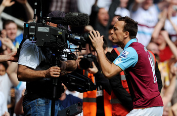 LONDON, ENGLAND - APRIL 02:  Mark Noble of West Ham United celebrates scoring his penalty with a TV cameraman during the Barclays Premier League match between West Ham United and Manchester United at the Boleyn Ground on April 2, 2011 in London, England.