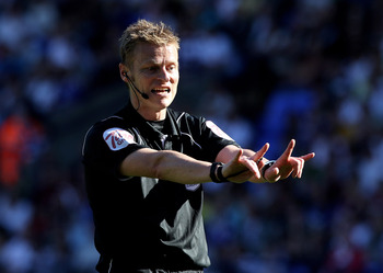 BOLTON, ENGLAND - APRIL 24:  Referee Mike Jones gestures during the Barclays Premier League match between Bolton Wanderers and Arsenal at the Reebok Stadium on April 24, 2011 in Bolton, England. (Photo by Michael Steele/Getty Images)
