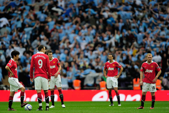 LONDON, ENGLAND - APRIL 16:  Man Utd players react after Yaya Toure of Manchester City scored the opening goal during the FA Cup sponsored by E.ON semi final match between Manchester City and Manchester United at Wembley Stadium on April 16, 2011 in Londo