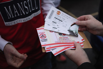 CRAWLEY, WEST SUSSEX - FEBRUARY 19:  Fans of the non-league football club Crawley Town hand out tickets before boarding coaches to Manchester to watch their team take on Manchester United in the FA Cup fifth round  on February 19, 2011 in Crawley, England