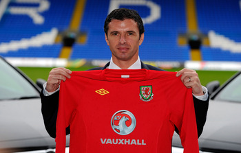 CARDIFF, WALES - JANUARY 12:  Wales manager Gary Speed holds up the team shirt at the launch of the announcment of Vauxhall as the new team sponsor at Cardiff City Stadium on January 12, 2011 in Cardiff, Wales.  (Photo by Stu Forster/Getty Images)