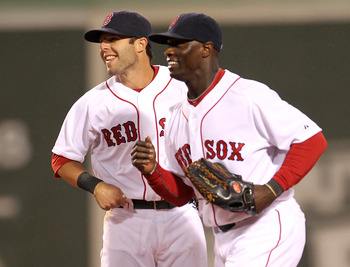 BOSTON, MA - APRIL 10:  Dustin Pedroia #15 and Mike Cameron #23 of the Boston Red Sox celebrate a win against the New York Yankees at Fenway Park April 10, 2011 in Boston, Massachusetts. (Photo by Jim Rogash/Getty Images)