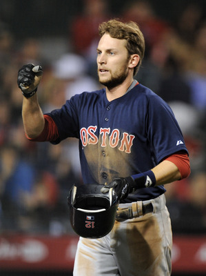 ANAHEIM, CA - APRIL 22:  Jed Lowrie #12 of the Boston Red Sox celebrates his run for a 4-0 lead over the Los Angeles Angels of Anaheim during the fifth inning at Angel Stadium on April 22, 2011 in Anaheim, California.  (Photo by Harry How/Getty Images)