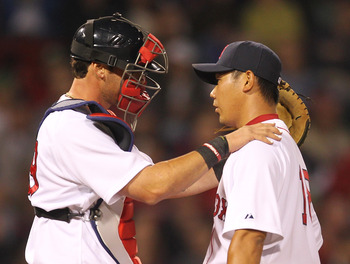 BOSTON, MA - APRIL 11:  Jarrod Saltalamacchia #39 consoles Daisuke Matsuzaka #18 of the Boston Red Sox after a six-run second inning against the Tampa Bay Rays at Fenway Park April 11, 2011 in Boston, Massachusetts. (Photo by Jim Rogash/Getty Images)