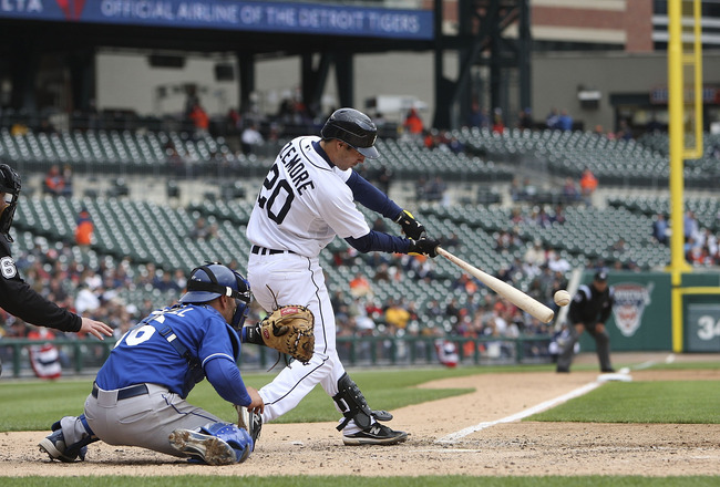 DETROIT - APRIL 13: Scott Sizemore #20 of the Detroit Tigers doubles down the left field line in the seventh inning scoring Gerald Laird #8 from second base against the Kansas City Royals on April 13, 2010 at Comerica Park in Detroit, Michigan. The Detroi