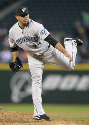 SEATTLE, WA - APRIL 12:  Starting pitcher Ricky Romero #24 of the Toronto Blue Jays pitches against the Seattle Mariners at Safeco Field on April 12, 2011 in Seattle, Washington. (Photo by Otto Greule Jr/Getty Images)