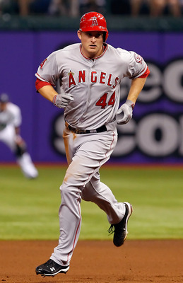 ST. PETERSBURG, FL - APRIL 29:  First baseman Mark Trumbo #44 of the Los Angeles Angels of Anaheim rounds the bases after his two run home run against the Tampa Bay Rays during the game at Tropicana Field on April 29, 2011 in St. Petersburg, Florida.  (Ph