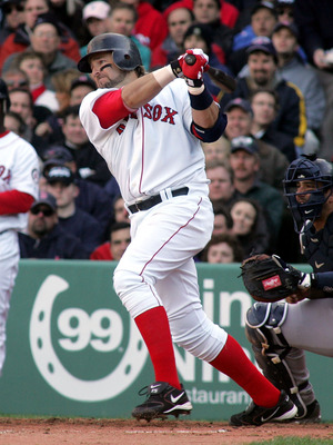 BOSTON - APRIL 11:  Kevin Millar #15 of the Boston Red Sox hits a two run base hit in the third inning against Mike Mussina of the New York Yankees scoring Trot Nixon and Manny Ramirez giving Boston a 4-0 lead during thier game at Fenway Park on April 11,