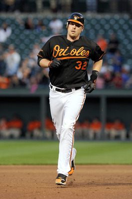 BALTIMORE, MD - APRIL 20:  Matt Wieters #32 of the Baltimore Orioles rounds the bases after hitting a home run in the second inning against the Minnesota Twins at Oriole Park at Camden Yards on April 20, 2011 in Baltimore, Maryland.  (Photo by Greg Fiume/