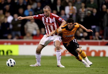 STOKE ON TRENT, ENGLAND - APRIL 26:  Marc Wilson of Stoke City (L) in action with Matt Jarvis of Wolves in action during the Barclays Premier League match between Stoke City and Wolverhampton Wanderers at Britannia Stadium on April 26, 2011 in Stoke on Tr