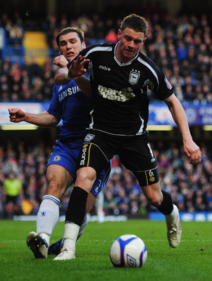 LONDON, ENGLAND - JANUARY 09:  Connor Wickham of Ipswich Town  holds off Branislav Ivanovic of Chelsea during the FA Cup sponsored by E.ON 3rd round match between Chelsea and Ipswich Town at Stamford Bridge on January 9, 2011 in London, England.  (Photo b