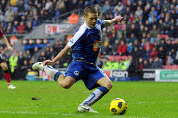 WIGAN, ENGLAND - FEBRUARY 05:  James McCarthy of Wigan Athletic scores to make it 1-1 during the Barclays Premier League match between Wigan Athletic and Blackburn Rovers at DW Stadium on February 5, 2011 in Wigan, England.  (Photo by Chris Brunskill/Gett