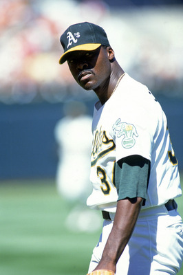 OAKLAND, CA - 1990:  Pitcher Dave Stewart #34 of the Oakland Athletics looks on from the mound during a game of the 1990 American League Season at the Oakland-Alameda County Coliseum in Oakland, California.   (Photo by Otto Greule Jr/Getty Images)