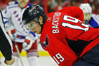WASHINGTON , DC - APRIL 23:  Nicklas Backstrom #19 of the Washington Capitals looks on during a face off against of the New York Rangers in Game Five of the Eastern Conference Quarterfinals during the 2011 NHL Stanley Cup Playoffs at the Verizon Center on