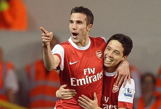LONDON, ENGLAND - APRIL 20:  Robin van Persie of Arsenal celebrates scoring their third goal with team mate Samir Nasri during the Barclays Premier League match between Tottenham Hotspur and Arsenal at White Hart Lane on April 20, 2011 in London, England.