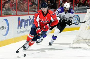 WASHINGTON, DC - FEBRUARY 12:  Mike Green #52 of the Washington Capitals handles the puck against Wayne Simmonds #17 of the Los Angeles Kings at the Verizon Center on February 12, 2011 in Washington, DC.  (Photo by Greg Fiume/Getty Images)