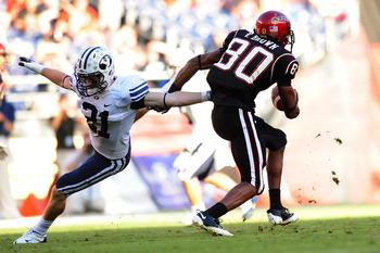 SAN DIEGO - OCTOBER 17:  Tyler Holt #31 of BYU Cougars tries to stop Vincent Brown #80 of San Diego State Aztecs at Qualcomm Stadium on October 17, 2009 in San Diego, California. BYU Cougars defeated the Aztecs 38-28  (Photo by Jacob de Golish/Getty Image
