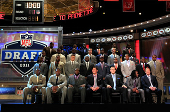 NEW YORK, NY - APRIL 28:  NFL Commissioner Roger Goodell (botom row R) poses for a photo on stage with the members of the 2011 Draft class and the 2011 Pro Football Hall of Fame class during the 2011 NFL Draft at Radio City Music Hall on April 28, 2011 in