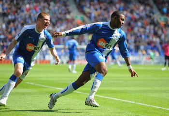 WIGAN, ENGLAND - APRIL 30: Charles N'Zogbia of Wigan celebrates scoring to make it 1-0 with team mate James McCarthy during the Barclays Premier League match between Wigan and Everton at the DW Stadium on April 30, 2011 in Wigan, England.  (Photo by Micha