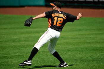 SCOTTSDALE, AZ - MARCH 18:  Nate Schierholtz #12 of the San Francisco Giants plays against during the spring training baseball game against the Los Angeles Dodgers at Scottsdale Stadium on March 18, 2011 in Scottsdale, Arizona.  (Photo by Kevork Djansezia