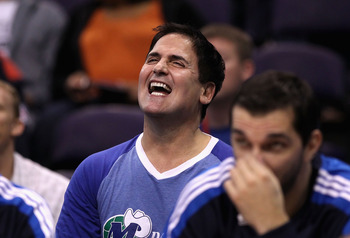 PHOENIX, AZ - MARCH 27:  Owner Mark Cuban of the Dallas Mavericks laughs during the NBA game against the Phoenix Suns at US Airways Center on March 27, 2011 in Phoenix, Arizona. The Mavericks defeated the Suns 91-83. NOTE TO USER: User expressly acknowled
