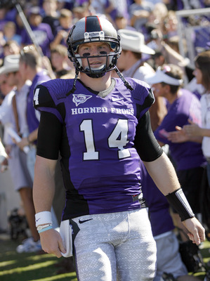 FORT WORTH, TX - OCTOBER 16:  Quarterback Andy Dalton #14 of the Texas Christian University Horned Frogs walks on the field against the Brigham Young University Cougars at Amon G. Carter Stadium on October 16, 2010 in Fort Worth, Texas.  (Photo by Tom Pen