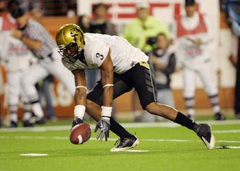 AUSTIN, TX - OCTOBER 10: Cornerback Jimmy Smith #3 of the Colorado Buffaloes picks up the loose ball which was knocked out of the hand of quarterback Colt McCoy of the Texas Longhorns as he rolled out in the second quarter on October 10, 2009 at Darrell K